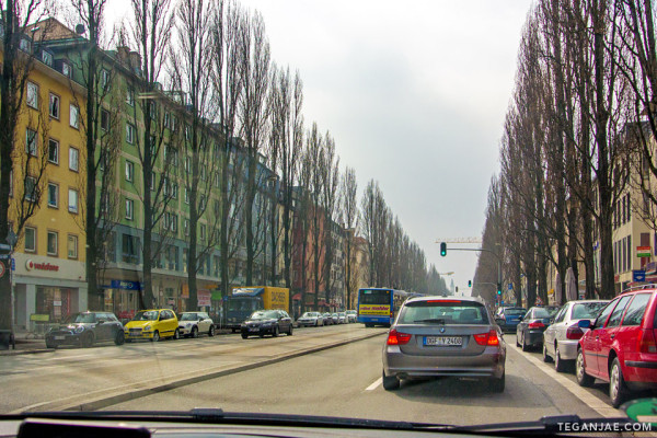 Driving along a tree lined street in Munich, Germany - Munich Travel Highlights